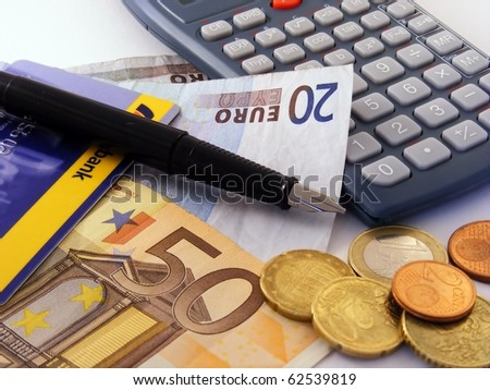 Euro money with calculator & credit card - stock photo