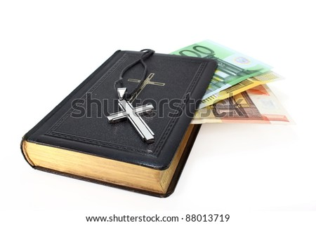 Euro note, song book and cross on a white background