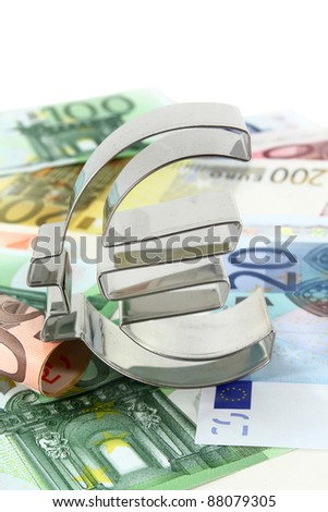 Euro notes and Euro symbol on a white background