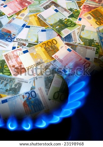 EURO notes and gas stove - stock photo
