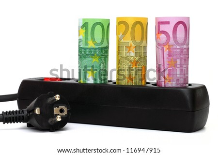 Euro notes in a triple socket symbolize the rising energy costs. - stock photo