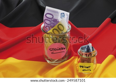 Euro notes in container on german flag - stock photo