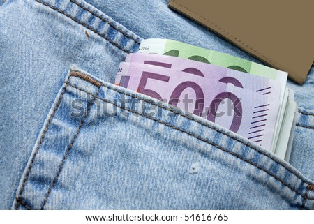 euro notes in the back pocket of pants - stock photo