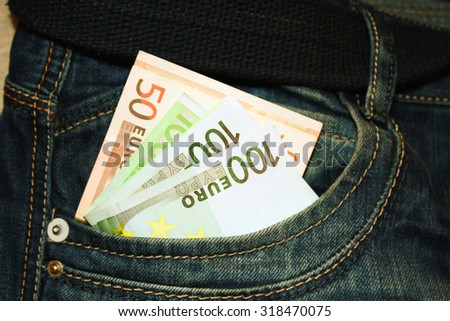 Euro notes in the pocket of jeans - stock photo