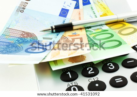 Euro Notes with Calculator and pen. closeup. small GRIP - stock photo