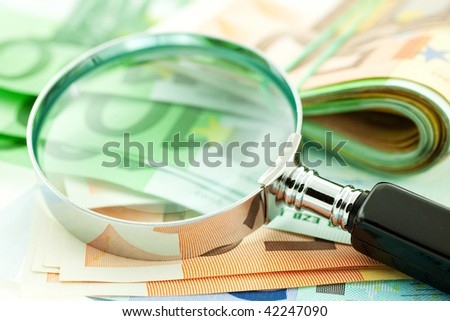 euro notes with magnifier. CloseUp. small GRIP - stock photo