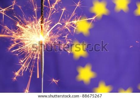 euro or european union flag and holiday sparkler showing celebration - stock photo