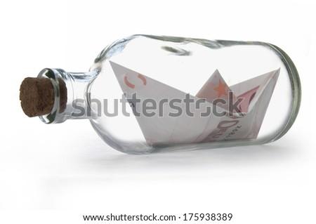 Euro paper boat inside a message bottle - stock photo