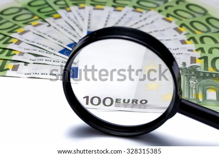 Euro paper Money Banknotes through a magnifying glass. Business concepts, cash, hundreds, closeup of banknotes, hundred, finances, investment, texture. Finance background. Isolated on white. - stock photo