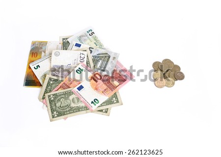 Euro Pound Dollar Swiss Franc against Russian Ruble coins on white background. Money from different countries - stock photo