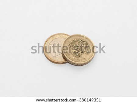 Euro's and sterling cash on background - stock photo