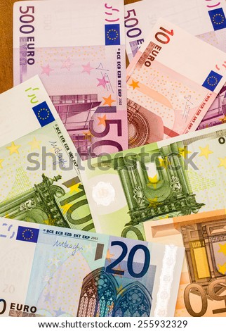 Euro scattered on the table - stock photo