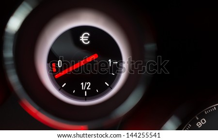 Euro sign fuel gauge nearing empty.