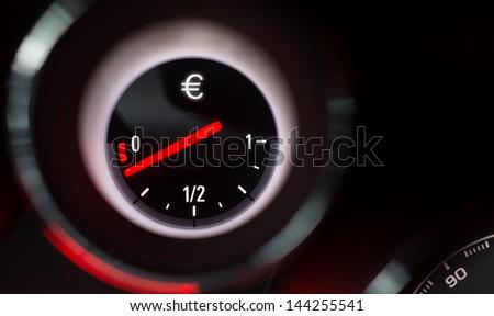 Euro sign fuel gauge nearing empty. - stock photo