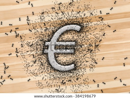 Euro symbol EU currency money icon that written by sugar grains on wood background. And the ants swarming at the Euro sign. Metaphor about monetary or business concept. - stock photo