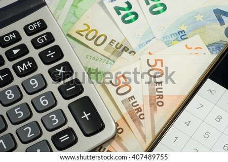 Euro zone money 50 and 100 euro bills, smartphone and calculator for finance and economic