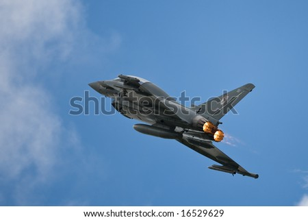 Eurofighter Typhoon climbing on afterburners - stock photo