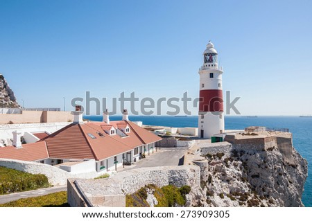 Europa Point Lighthouse on a shore of Gibraltar - stock photo