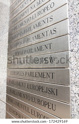 Europaen parlament table written in european languages, on the front wall of the main building, Brussels, Belgium. - stock photo