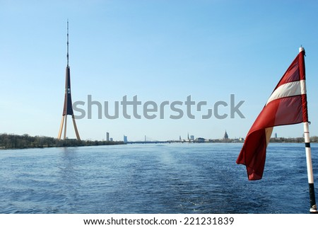 Europe, Baltic, Latvia, Riga. Television tower against a panorama of Riga - stock photo