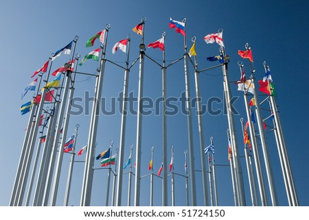 europe countries flags arranged in a circle on blue sky - stock photo