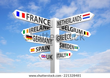 Europe destinations and flags signpost against blue sky  stock photo