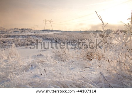Europe freezes. Winter high-voltage transmission tower. - stock photo