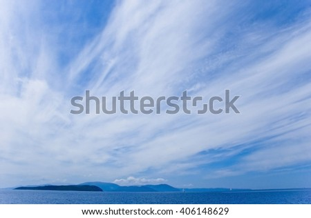 Europe, Greece. Beautiful clouds over islands and the Mediterranean Sea