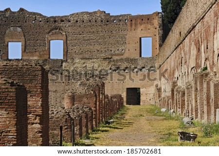 Europe Italy Rome ancient roman forum amphitheatre ruins in famous archaeological site with row of ruined columns and brick walls - stock photo