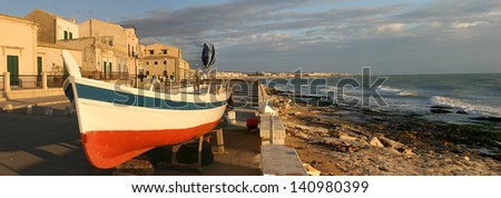 europe, italy, sicily, donnalucata, landscape with boat - stock photo