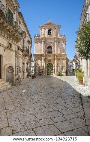 europe, italy, sicily, scicli, old baroque street and st. Michele church - stock photo