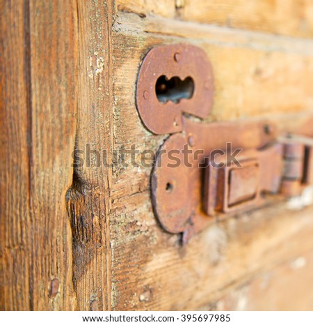 europe old in  italy  antique close brown door and rusty lock  closeup - stock photo