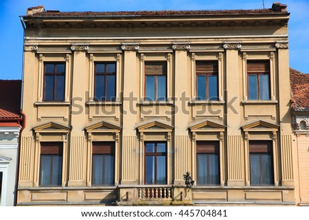 Europe, Romania, Brasov, Council Square, Stone building with many windows.