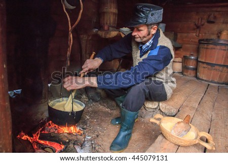 Europe, Romania, Bucovina, Campulung  Moldovenesc, Nov. 7, 2015. local shepherd and craftsman making polenta.