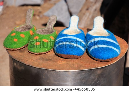 Europe, Romania, Transylvania, Carpathian Mountains, Viscri, boiled wool house slippers or shoes. - stock photo