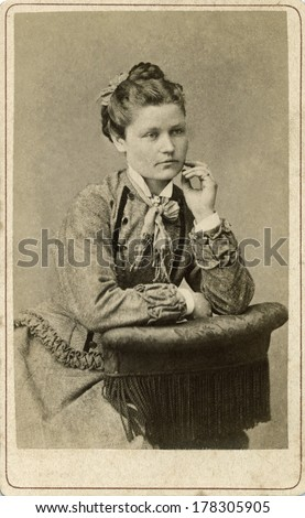 EUROPE - SWEDEN - CIRCA 1875 - A vintage Cartes de visite photo of young woman sitting dressed in Victorian style dress with fancy collar. Photo from the Victorian era. CIRCA 1875 - stock photo