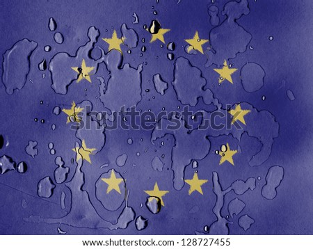 Europe Union flag painted on covered with water drops - stock photo
