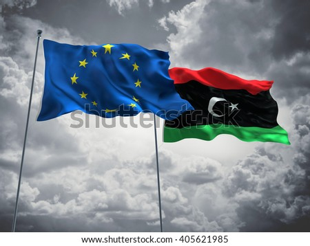 Europe Union & Libya Flags are waving in the sky with dark clouds - stock photo