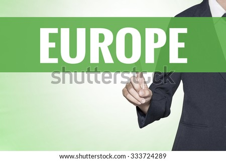 Europe word on green virtual screen touching by business woman - stock photo