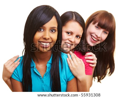 European and African and Asian women smiling together - stock photo