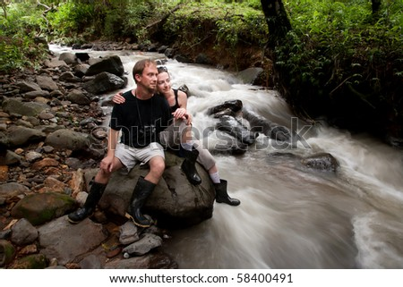 European and American couple in Costa Rica near river