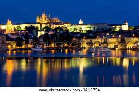 European city at dusk, river Vltava - stock photo
