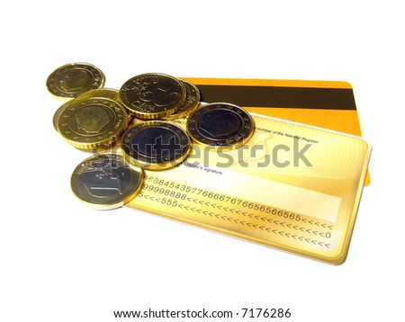 European coins lying on some credit cards isolated on a white background