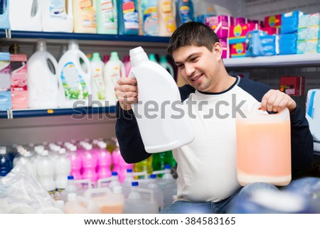 european customer buying detergents for laundry in shopping mall - stock photo