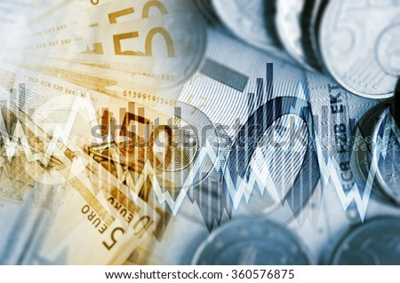 European Economy Concept. Euro Currency Fifty Euros Banknotes and Euro Cent Coins with Some Line Graphs. - stock photo