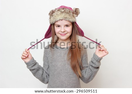 European fashion little girl wearing jeans and sweater