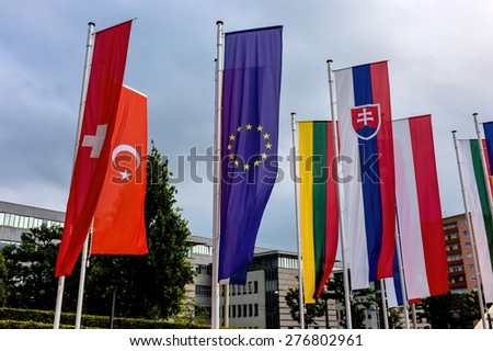 european flag and other flags, symbolism of diplomacy and international cooperation - stock photo