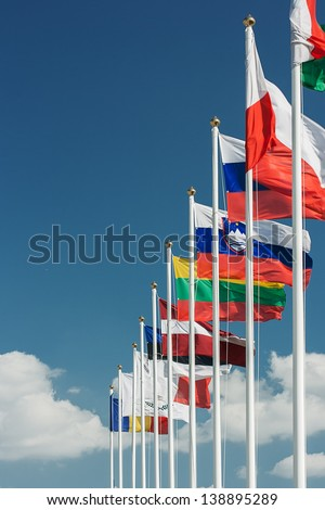 European flags against blue sky - stock photo