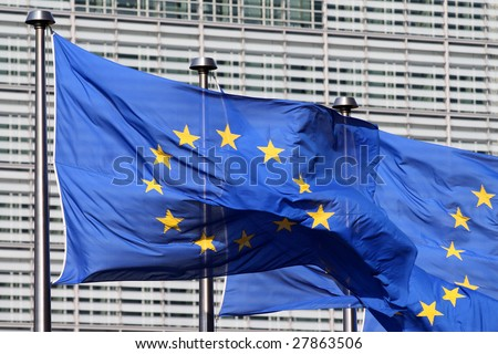 European flags floating in front of the European Commission Building in Brussels, wind blowing from the left - stock photo