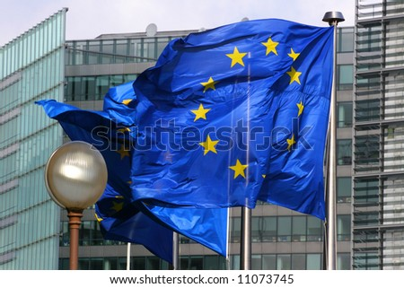 European flags floating in front of the European Council Building in Brussels - stock photo